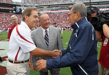TUSCALOOSA, AL - SEPTEMBER 11:  In this image provided by the University of Alabama, (L-R) head coach Nick Saban of the Alabama Crimson Tide, retired coach Bobby Bowden and head coach Joe Paterno of the Penn State Nittany Lions converse during pre-game wa