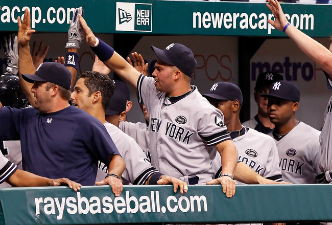 ST. PETERSBURG, FL - SEPTEMBER 15:  The New York Yankees celebrate Curtis Granderson's seventh inning home run against the Tampa Bay Rays during the game at Tropicana Field on September 15, 2010 in St. Petersburg, Florida.  (Photo by J. Meric/Getty Images