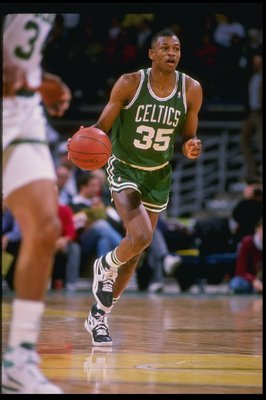 Guard Reggie Lewis of the Boston Celtics dribbles the ball down the court during a game against the Milwaukee Bucks at the Bradley Center in Milwaukee, Wisconsin.
