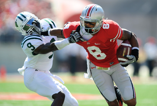 COLUMBUS, OH - SEPTEMBER 18:  DeVier Posey #8 of the Ohio State Buckeyes stiff arms his brother Julian Posey #9 of the Ohio Bobcats at Ohio Stadium on September 18, 2010 in Columbus, Ohio.  (Photo by Jamie Sabau/Getty Images)