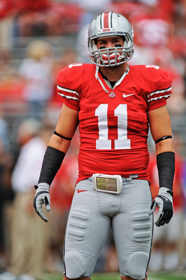 COLUMBUS, OH - SEPTEMBER 11:  Jake Stoneburner #11 of the Ohio State Buckeyes warms up before a game against the Miami Hurricanes at Ohio Stadium on September 11, 2010 in Columbus, Ohio.  (Photo by Jamie Sabau/Getty Images)