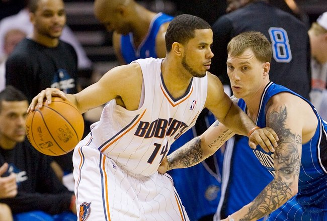CHARLOTTE, NC - APRIL 26: D.J. Augustin #14 of the Charlotte Bobcats tries to dribble past Jason Williams #44 of the Orlando Magic at Time Warner Cable Arena on April 26, 2010 in Charlotte, North Carolina.  The Magic defeated the Bobcats 99-90 to complete