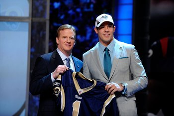 NEW YORK - APRIL 22:  Quarterback Sam Bradford (R) from the Oklahoma Sooners poses with NFL Commissioner Roger Goodell as they hold up a St. Louis Rams jersey after the Rams selected Bradford numer 1 overall during the first round of the 2010 NFL Draft at