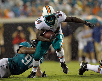 JACKSONVILLE, FL - AUGUST 21:  Terrance Knighton #96 of the Jacksonville Jaguars attempts to tackle Ricky Williams #34 of the Miami Dolphins during the preseason game at EverBank Field on August 21, 2010 in Jacksonville, Florida.  (Photo by Sam Greenwood/