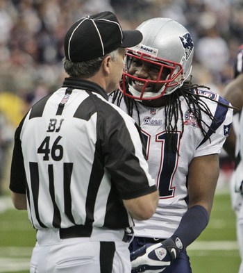 HOUSTON - JANUARY 03:  Safety Brandon Meriweather #31 of the New  England Patriots talks with back judge Perry Paganalli #46 after a personal foul was called on safety James Sanders at Reliant Stadium on January 3, 2010 in Houston, Texas.  (Photo by Bob L
