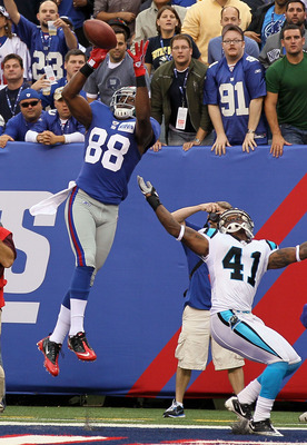 EAST RUTHERFORD, NJ - SEPTEMBER 12:  Hakeem Nicks #88 of the New York Giants goes up for a his second touchdown reception against Captain Munnerlyn #41 of the Carolina Panthers on September 12, 2010 at the New Meadowlands Stadium in East Rutherford, New J