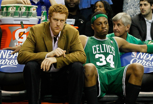 ORLANDO, FL - MAY 26:  (L-R) Brian Scalabrine and Paul Pierce #34 of the Boston Celtics look on dejected from the bench in the final minutes of their 113-92 loss to the Orlando Magic in Game Five of the Eastern Conference Finals during the 2010 NBA Playof