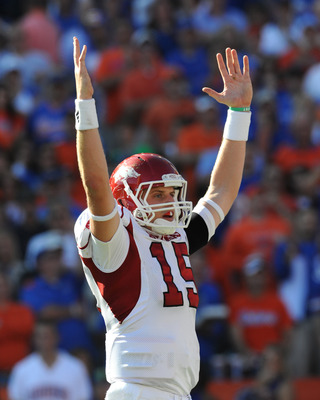 GAINESVILLE, FL - OCTOBER 17: Quarterback Ryan Mallett #15 of the Arkansas Razorbacks signals a touchdown against the Florida Gators October 17, 2009 at Ben Hill Griffin Stadium in Gainesville, Florida.  (Photo by Al Messerschmidt/Getty Images)