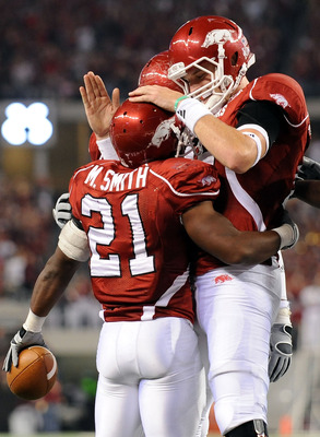 ARLINGTON, TX - OCTOBER 03:  Quarterback Ryan Mallett #15 celelbrates a touchdown with Michael Smith #21 of the Arkansas Razorbacks against the Texas A&M Aggies at Dallas Cowboys Stadium on October 3, 2009 in Arlington, Texas.  (Photo by Ronald Martinez/G