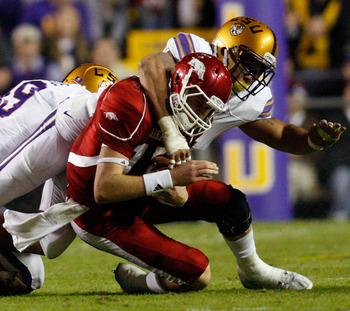 BATON ROUGE, LA - NOVEMBER 28:  Quarterback Ryan Mallett #15 of the Arkansa Razorbacks is tackled by Rahim Alem #84 of the Louisiana State University Tigers at Tiger Stadium on November 28, 2009 in Baton Rouge, Louisiana.  (Photo by Chris Graythen/Getty I