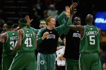 CHARLOTTE, NC - NOVEMBER 24:  Brian Scalabrine #44 high fives teammate Kevin Garnett #5 of the Boston Celtics during the game against the Charlotte Bobcats on November 24, 2007 at Charlotte Bobcats Arena in Charlotte, North Carolina.  The Celtics won 96-9