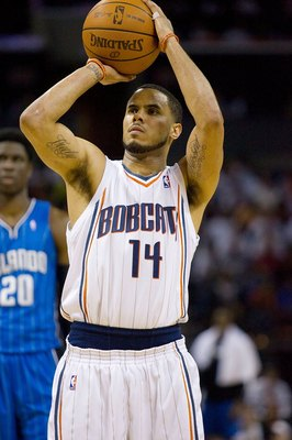 CHARLOTTE, NC - APRIL 26: D.J. Augustin #14 of the Charlotte Bobcats attempts a free throw against the Orlando Magic at Time Warner Cable Arena on April 26, 2010 in Charlotte, North Carolina.  The Magic defeated the Bobcats 99-90 to complete the four game
