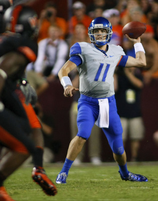 LANDOVER, MD - SEPTEMBER 06:  Quarterback Kellen Moore #11 of the Boise State Broncos passes against the Virginia Tech Hokies at FedExField on September 6, 2010 in Landover, Maryland.  (Photo by Geoff Burke/Getty Images)