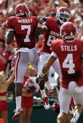 NORMAN, OK - SEPTEMBER 11:  (L-R) DeMarco Murray #7 and Ryan Broyles #85 of the Oklahoma Sooners celebrate a touchdown against the Florida State Seminoles in the first quarter at Gaylord Family Oklahoma Memorial Stadium on September 11, 2010 in Norman, Ok