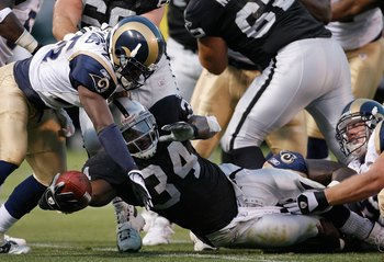OAKLAND, CA - AUGUST 24:  Running back LaMont Jordan #34 of the Oakland Raiders is tackled by Corey Chavous #25 of the St. Louis Rams during a preseason game on August 24, 2007 at McAfee Coliseum.  (Photo by Greg Trott/Getty Images)