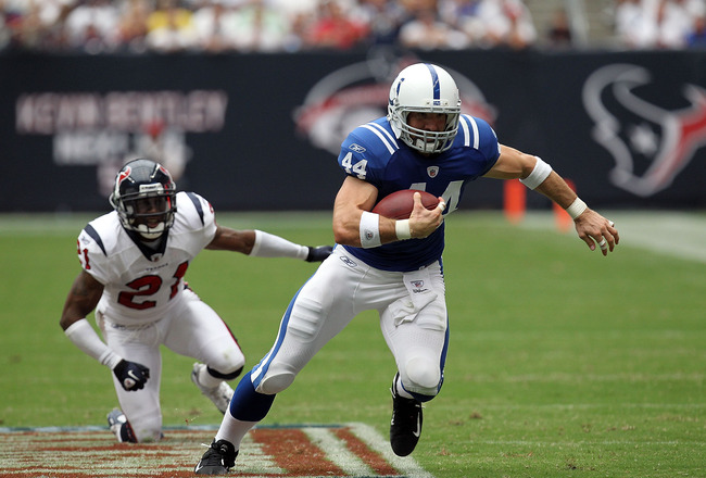 HOUSTON - SEPTEMBER 12:  Tight end Dallas Clark #44 of the Indianapolis Colts runs the ball against Brice McCain #21 of the Houston Texans during the NFL season opener at Reliant Stadium on September 12, 2010 in Houston, Texas.  (Photo by Ronald Martinez/