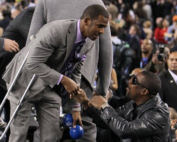 ARLINGTON, TX - FEBRUARY 14:  Chris Paul #3 of the Western Conference shakes hands with actor Chris Tucker during the NBA All-Star Game, part of 2010 NBA All-Star Weekend at Cowboys Stadium on February 14, 2010 in Arlington, Texas. The Eastern Conference
