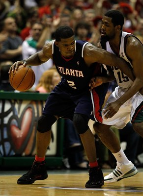 MILWAUKEE - APRIL 30: Joe Johnson #2 of the Atlanta Hawks moves against John Salmons #15 of the Milwaukee Bucks in Game Six of the Eastern Conference Quarterfinals during the 2010 NBA Playoffs at the Bradley Center on April 30, 2010 in Milwaukee, Wisconsi