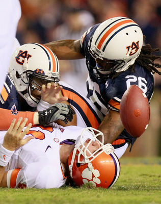 AUBURN, AL - SEPTEMBER 18:  Antoine Carter #45 and Mike McNeil #26 of the Auburn Tigers tackle quarterback Kyle Parker #11 of the Clemson Tigers at Jordan-Hare Stadium on September 18, 2010 in Auburn, Alabama.  (Photo by Kevin C. Cox/Getty Images)