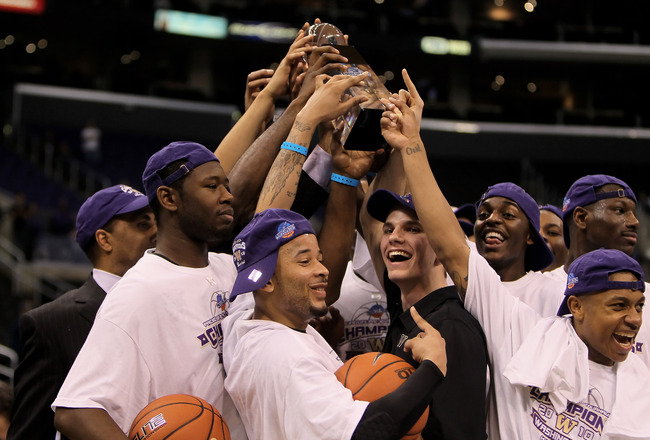 LOS ANGELES, CA - MARCH 13:  The Washington Huskies celebrate with the trophy following their victory over the Cal Golden Bears in the championship game of the Pac-10 Basketball Tournament at Staples Center on March 13, 2010 in Los Angeles, California. Wa