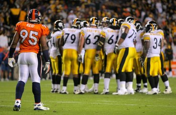 DENVER - NOVEMBER 09:  Defensive end Darrell Reid #95 of  the Denver Broncos waits for action at the line of scrimmage as quarterback Ben Roethlisberger #7 of the Pittsburgh Steelers runs the offensive huddle during NFL action at Invesco Field at Mile Hig