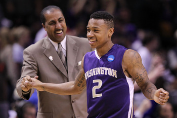 SAN JOSE, CA - MARCH 20:  Guard Isaiah Thomas #2 and head coach Lorenzo Romar of the Washington Huskies celebrate after their 82-64 win over the New Mexico Lobos in the second round of the 2010 NCAA men's basketball tournament at HP Pavilion on March 20,