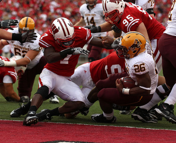 MADISON, WI - SEPTEMBER 18: Cameron Marshall #26 of the Arizona State Sun Devils crosses the goal line to score a touchdown in the 4th quarter as Aaron Henry #7 of the Wisconsin Badgers tries for the tackle at Camp Randall Stadium on September 18, 2010 in