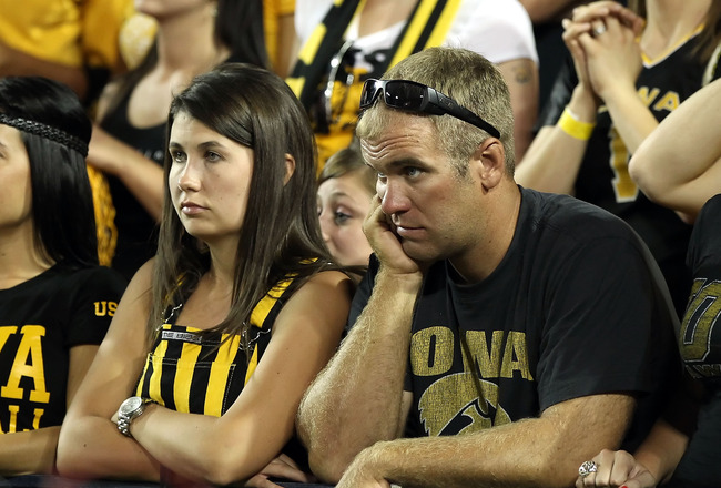 TUCSON, AZ - SEPTEMBER 18:  Fans of the Iowa Hawkeyes react in the final moments of the college football game against the Arizona Wildcats at Arizona Stadium on September 18, 2010 in Tucson, Arizona.  The Wildcats defeated the Hawkeyes 34-27.  (Photo by C
