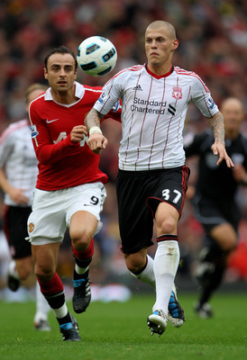 MANCHESTER, ENGLAND - SEPTEMBER 19:  Dimitar Berbatov of Manchester United competes for the ball with Martin Skrtel of Liverpool during the Barclays Premier League match between Manchester United and Liverpool at Old Trafford on September 19, 2010 in Manc