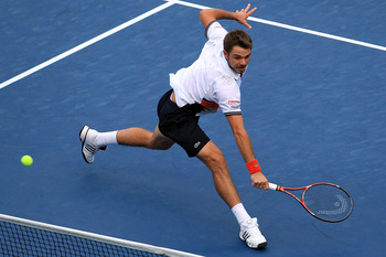 NEW YORK - SEPTEMBER 09:  Stanislas Wawrinka of Switzerland returns a shot against Mikhail Youzhny of Russia during his men's single quarterfinal match on day eleven of the 2010 U.S. Open at the USTA Billie Jean King National Tennis Center on September 9,