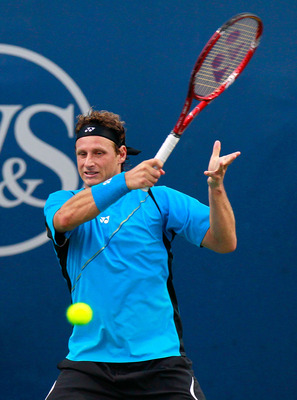 CINCINNATI - AUGUST 17:  David Nalbandian of Argentina returns a forehand to Ivan Ljubicic of Croatia during Day 2 of the Western & Southern Financial Group Masters at the Lindner Family Tennis Center on August 17, 2010 in Cincinnati, Ohio.  (Photo by Kev