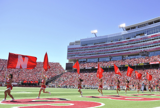 LINCOLN, NEBRASKA - SEPTEMBER 11: The Nebraska Cornhuskers flag corps celebrates a Nebraska touchdown during the second half of their football game between the Nebraska Cornhuskers and the Idaho Vandals at Memorial Stadium on September 4, 2010 in Lincoln,