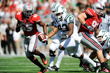 COLUMBUS, OH - SEPTEMBER 18:  Running back Dallas Brown #23 of the Ohio Bobcats fumbles the ball as he is pursued by Jonathan Newsome #55 of the Ohio State Buckeyes at Ohio Stadium on September 18, 2010 in Columbus, Ohio. Brown recovered his own fumble.