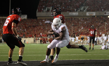 LUBBOCK, TX - SEPTEMBER 18:  Tight end Barrett Matthews #89 of the Texas Longhorns makes a touchdown passs reception against Bront Bird #20 and Cody Davis #16 of the Texas Tech Red Raiders in the fourth quarter at Jones AT&T Stadium on September 18, 2010