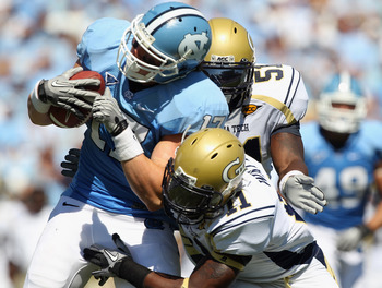 CHAPEL HILL, NC - SEPTEMBER 18:  Teammates Brandon Watts #11 and Brad Jefferson of the Georgia Tech Yellow Jackets tackle Zack Pianalto #17 of the North Carolina Tar Heels during their game at Kenan Stadium on September 18, 2010 in Chapel Hill, North Caro