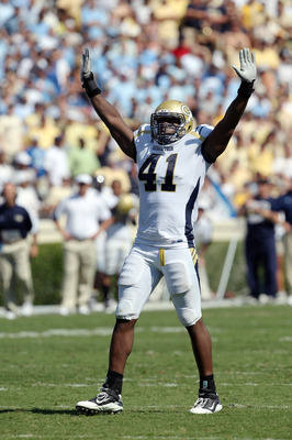 CHAPEL HILL, NC - SEPTEMBER 18:  Anthony Egbuniwe #41 of the Georgia Tech Yellow Jackets celebrates after a field goal giving them the lead against the North Carolina Tar Heels during their game at Kenan Stadium on September 18, 2010 in Chapel Hill, North
