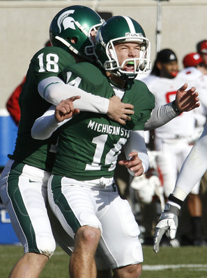 EAST LANSING, MI - NOVEMBER 01:  Brett Swenson #14 of the Michigan State Spartans reacts with Aaron Bates #18 after kicking game winning field goal to beat the Wisconsin Badgers 25-24 on November 1, 2008 at Spartan Stadium in East Lansing, Michigan.  (Pho
