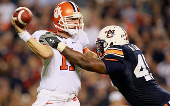 AUBURN, AL - SEPTEMBER 18:  Antoine Carter #45 of the Auburn Tigers pressures quarterback Kyle Parker #11 of the Clemson Tigers at Jordan-Hare Stadium on September 18, 2010 in Auburn, Alabama.  (Photo by Kevin C. Cox/Getty Images)