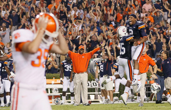 AUBURN, AL - SEPTEMBER 18:  Quarterback Cameron Newton #2 and Neiko Thorpe #15 of the Auburn Tigers celebrate after Chandler Catanzaro #39 of the Clemson Tigers missed a field goal in overtime to give the Auburn Tigers a 27-24 win at Jordan-Hare Stadium o