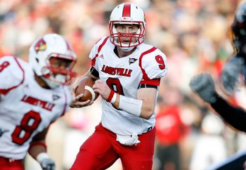 CINCINNATI - OCTOBER 24:  Adam Froman #9 of the Louisville Cardinals runs with the ball during the Big East Conference game against the Cincinnati Bearcats at Nippert Stadium on October 24, 2009 in Cincinnati, Ohio.  (Photo by Andy Lyons/Getty Images)