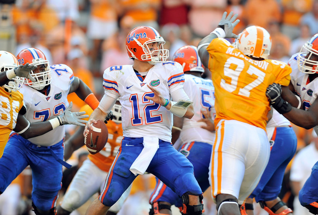 KNOXVILLE, TN - SEPTEMBER 18:  Quarterback John Brantley #12 of the Florida Gators drops back to pass against the Tennessee Volunteers at Neyland Stadium on September 18, 2010 in Knoxville, Tennessee.  (Photo by Grant Halverson/Getty Images)