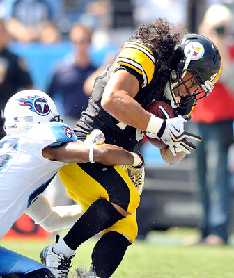 NASHVILLE, TN - SEPTEMBER 19:  Troy Polamalu #43 of the Pittsburgh Steelers intercepts a pass in the end zone intended for Nate Washington #85 of the Tennessee Titans  during the first half at LP Field on September 19, 2010 in Nashville, Tennessee.  (Phot