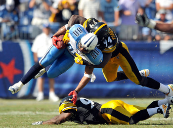NASHVILLE, TN - SEPTEMBER 19:  Lawrence Timmons #94 of the Pittsburgh Steelers tackles Bo Scaife #80 of the Tennessee Titans at LP Field on September 19, 2010 in Nashville, Tennessee. The Steelers won 19-11.  (Photo by Grant Halverson/Getty Images)