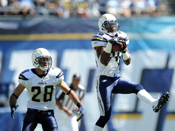 SAN DIEGO - SEPTEMBER 19:  Antoine Cason #20 of the San Diego Chargers makes an interception in front of Steve Gregory #28 against the Jacksonville Jaguars during the second quarter at Qualcomm Stadium on September 19, 2010 in San Diego, California.  (Pho