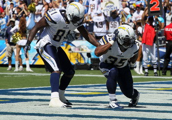 SAN DIEGO - SEPTEMBER 19:  Running back Mike Tolbert #35 and tight end Randy McMichael #81 of the San Diego Chargers celebrate Tolbert's first quarter touchdown run against the Jacksonville Jaguars at Qualcomm Stadium on lbSeptember 19, 2010 in San Diego,