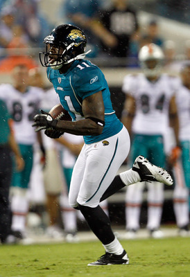 JACKSONVILLE, FL - AUGUST 21:  Mike Sims-Walker #11 of the Jacksonville Jaguars runs after making a reception during the preseason game against the Miami Dolphins at EverBank Field on August 21, 2010 in Jacksonville, Florida.  (Photo by Sam Greenwood/Gett