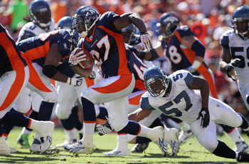 DENVER - SEPTEMBER 19:  Running back Knowshon Moreno #27 of the Denver Broncos picks up yardage as he eludes linebacker David Hawthorne #57 of the Seattle Seahawks at INVESCO Field at Mile High on September 19, 2010 in Denver, Colorado.  (Photo by Doug Pe