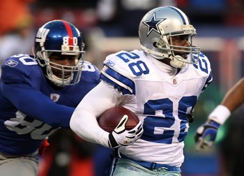 EAST RUTHERFORD, NJ - DECEMBER 06:  Felix Jones #28 of the Dallas Cowboys runs the ball against the New York Giants on December 6, 2009 at Giants Stadium in East Rutherford, New Jersey. The Giants defeated the Cowboys 31-24.  (Photo by Jim McIsaac/Getty I