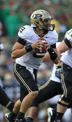 SOUTH BEND, IN - SEPTEMBER 04: Robert Marve #9 of the Purdue Boilermakers rolls out to look for a receiver against the Notre Dame Fighting Irish at Notre Dame Stadium on September 4, 2010 in South Bend, Indiana. Notre Dame defated Purdue 23-12.  (Photo by