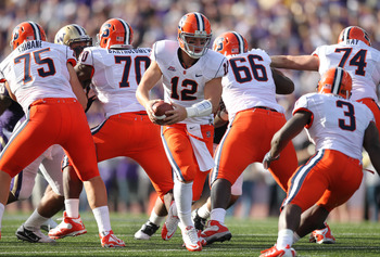 SEATTLE - SEPTEMBER 11:  Quarterback Ryan Nassib #12 of the Syracuse Orange drops back to pass against the Washington Huskies on September 11, 2010 at Husky Stadium in Seattle, Washington. (Photo by Otto Greule Jr/Getty Images)